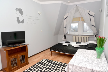 ascetic: Double hotel room with a portrait of the Russian poetess Anna Akhmatova on a wall