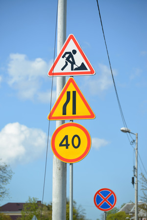 Road signs Roadwork, Narrowing of the road at the left, Restriction of the maximum speed of 40 km, The stop is forbidden Stock Photo