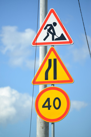 narrowing: Road signs Roadwork, Narrowing of the road at the left, Restriction of the maximum speed of 40 km Stock Photo