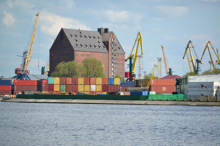 warehouse building: KALININGRAD, RUSSIA - MAY 03, 2015: The container terminal and the old warehouse building of the German construction in trade seaport