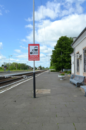 gusev: The forbidding banner It is forbidden to jump on railway tracks! on the station platform Gusev, the Kaliningrad region
