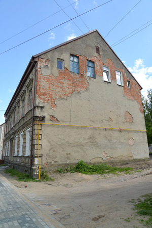 peeledoff: The old peeled-off building of the German construction in the city Gusev, the Kaliningrad region Stock Photo