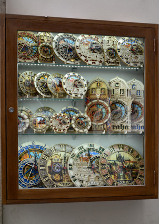 chiming: PRAGUE, CZECH REPUBLIC - MAY 28, 2014: A show-window with souvenir models of the Prague astronomical clock (chiming clock)