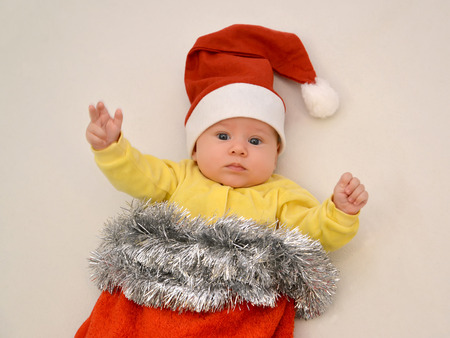 baby in suit: Portrait of the baby in a New Years suit Santa Claus on a light background Stock Photo