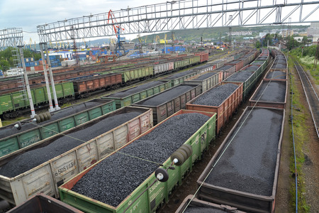 polar station: MURMANSK, RUSSIA - JULY 17, 2015: Freight trains with coal stand on a cargo site of railway station