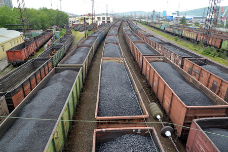 MURMANSK, RUSSIA - JULY 17, 2015: Cargo trains with coal stand on railway station Stock fotó - 44746855