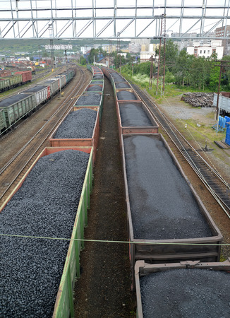 polar station: MURMANSK, RUSSIA - JULY 17, 2015: Cargo structures with coal stand Murmansk at railway station