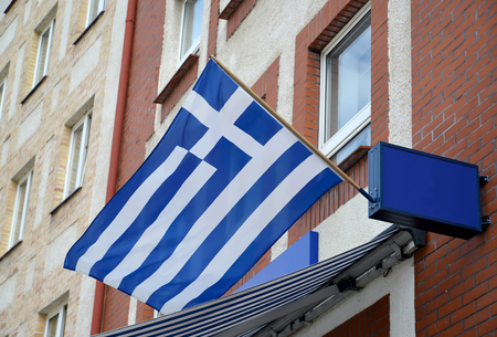 hellenic: National flag of the Hellenic Republic flutters on a building facade