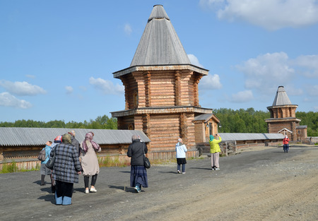 serf: MURMANSK, RUSSIA - JULY 18, 2015: Group of pilgrims in the territory of the Sacred and Troitsk Trifonov-Pechengsky mans monastery