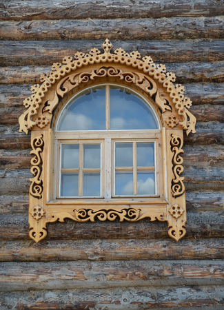 timbered: Window with wooden carved platbands on a timbered wall