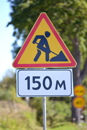 roadwork: Road signs Roadwork, Distance of 150 m against greens
