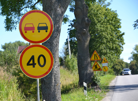 km: Road signs Overtaking is forbidden, Restriction of the maximum speed of 40 km against the road