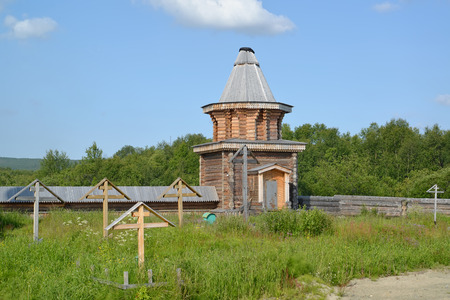 monastic: Wooden watchtower and monastic cemetery in the territory of the Sacred and Troitsk Trifonov-Pechengsky mans monastery. Murmansk region