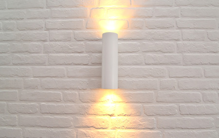 sconce: The wall lamp with illumination on a white brick wall