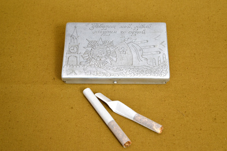 selfmade: Old self-made cigarette case of a wartime and two cigarettes