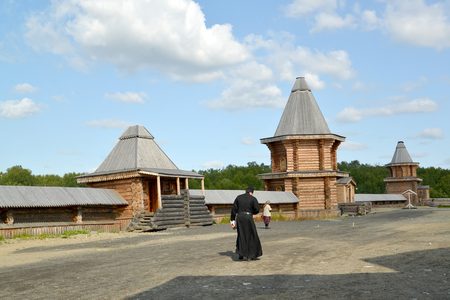 poorly: The monk goes across the territory of the Sacred and Troitsk Trifonov-Pechengsky mans monastery. Murmansk region Editorial