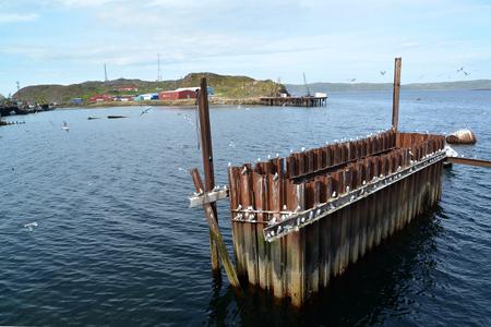 the thrown: The thrown construction metal design in the Barents Sea. Settlement of Teriberka, Murmansk region