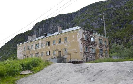the thrown: The thrown house in the settlement of Teriberka. Murmansk region