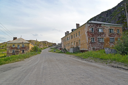 the thrown: The street with the thrown houses in the settlement of Teriberka. Murmansk region