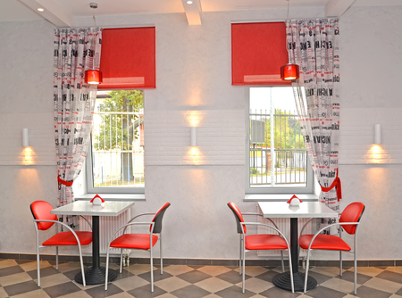 wall sconce: Interior of cafe with red chairs Editorial