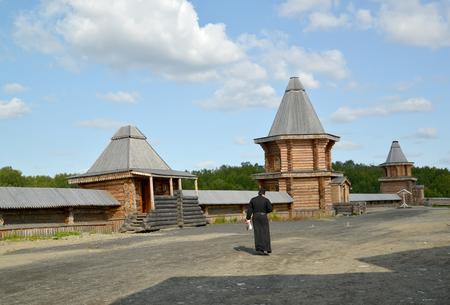 mans: The monk goes across the territory of the Sacred and Troitsk Trifonov-Pechengsky mans monastery. Murmansk region Stock Photo