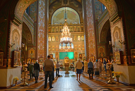 church service: PETERHOF, RUSSIA - JULY 24, 2015: Believers stand on church service in Saint Pyotr and Pavels cathedral