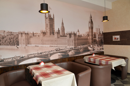 plafond: Fragment of an interior of modern cafe with the photo of the Westminster palace on a wall