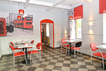 stylization: Interior of modern cafe in red and light tones. Stylization under the London landscape Stock Photo