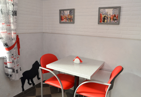 little table: Little table and red chairs in modern cafe. Interior
