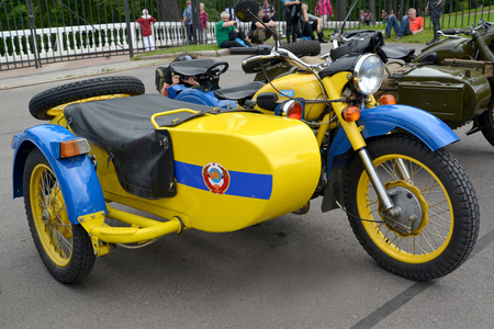 militia: PETERHOF, RUSSIA - JULY 26, 2015: The old Soviet militia motorcycle Ural with a carriage costs at a street exhibition