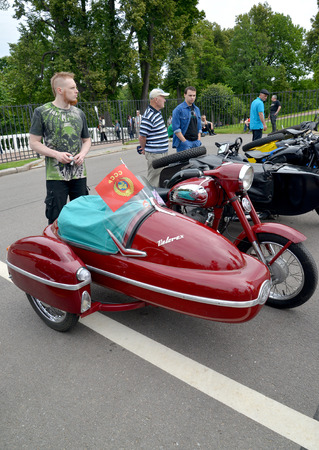 czechoslovak: PETERHOF, RUSSIA - JULY 26, 2015: The old Czechoslovak Java motorcycle (Jawa) with the side trailer costs at a street exhibition Editorial