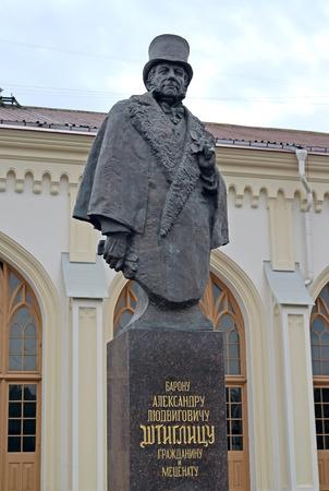 industrialist: Monument to the baron Alexander Lyudvigovich Shtiglits against the railway station of station New Peterhof