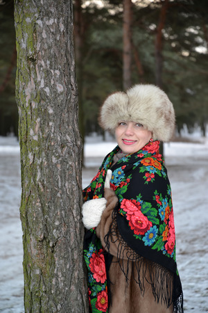 age 35 40 years: Portrait of the joyful woman of average years in the winter pine wood Stock Photo