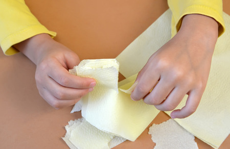 breaking off: Napkin breaking for production of a card in the fluffy application equipment Stock Photo