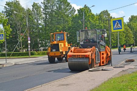 carriageway: PETERHOF, RUSSIA - JULY 24, 2015: Laying of new asphalt on a carriageway