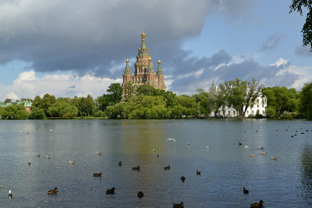 holguin: View of a cathedral of Saints Pyotr and Pavel on the bank of Holguin of a pond in Peterhof