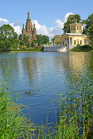 holguin: PETERHOF, RUSSIA - JULY 24, 2015: A view of a cathedral of Saints Pyotr and Pavel and Tsaritsyn the pavilion on the bank of Holguin of a pond Editorial