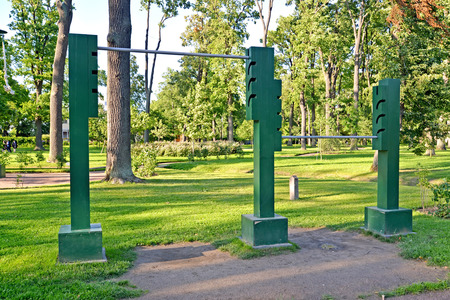 sports shell: PETERHOF, RUSSIA - JULY 24, 2015: Horizontal bar two-flying (complex of gymnastic games). Alexandria park Editorial