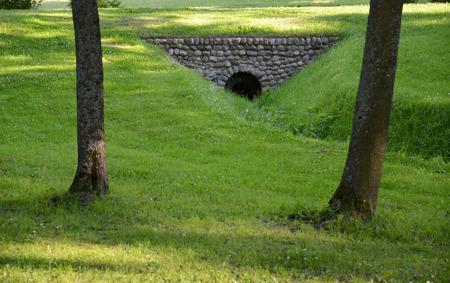 throughput: Water throughput pipe for a stream in park