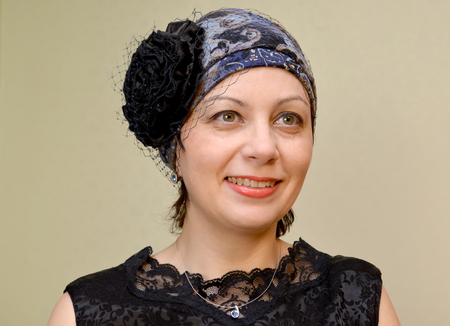average woman: Portrait of the woman of average years in a hat with a veil on a light background Stock Photo