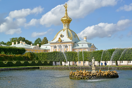 storeroom: PETERHOF, RUSSIA - JULY 24, 2015: Fountains of Square ponds against the museum Special Storeroom. Top garden Editorial