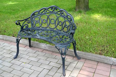 and st petersburg: Decorative metal bench in park. St. Petersburg
