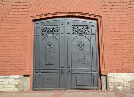 metal gate: Brick facade with metal gate.