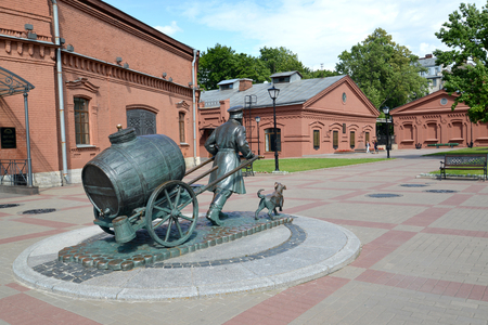 wheel barrel: ST. PETERSBURG, RUSSIA - JULY 15, 2015: A view of a monument to the St. Petersburg water carrier in the territory of the museum World of Water St. Petersburg