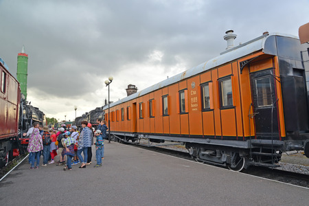 excursion: ST. PETERSBURG, RUSSIA - JULY 23, 2015: School excursion group in the Museum of railway equipment Editorial