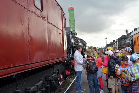 ST. PETERSBURG, RUSSIA - JULY 23, 2015: The school excursion group listens to the guide on the platform