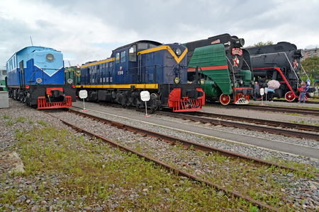 poorly: ST. PETERSBURG, RUSSIA - JULY 23, 2015: Old locomotives stand on ways