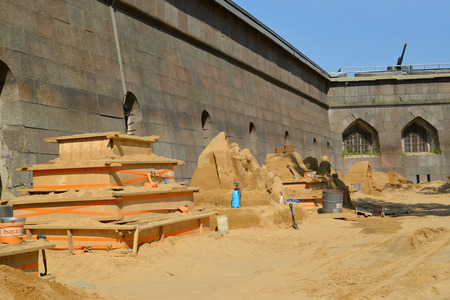 ST. PETERSBURG, RUSSIA - JULY 13, 2014: The platform with sandy sculptures at the Peter and Paul Fortress. Annual international festival of sandy sculptures