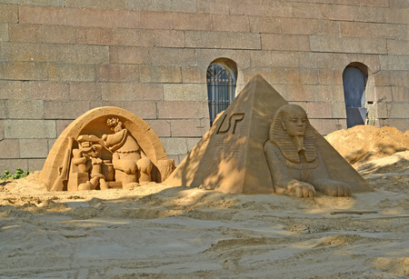serf: ST. PETERSBURG, RUSSIA - JULY 13, 2014: Sandy sculptures at the Peter and Paul Fortress. Annual international festival of sandy sculptures