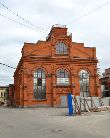 poorly: ST. PETERSBURG, RUSSIA - JULY 10, 2014: Restoration of the building of Nevsky Cosmetics factory